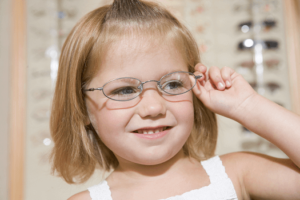 young child with glasses for a lazy eye